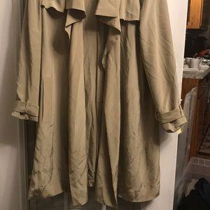 Knee length tan jacket.